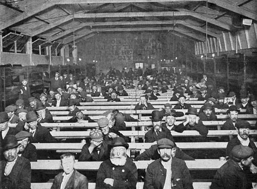 Stock Photo: 1746-271 The Penny Sit-Up for men, where the homeless could find shelter sitting on a bench for a penny a night. Bunks round edge of room were more expensive, Salvation Army Shelter, Blackfriars, London, England, Early 20th Century