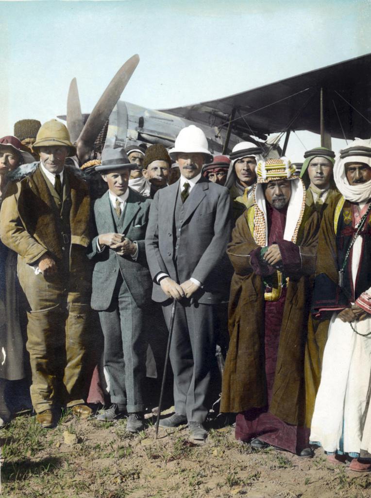 On the airfield at Amman,  Jordan, April 1921:  T E Lawrence,  Sir Herbert Samuel (British High Commissioner of Palestine), Emir Abdullah. Woman far left, possibly Gertrude Bell. Sheik Majid Pasha el Adwan, far right. : Stock Photo
