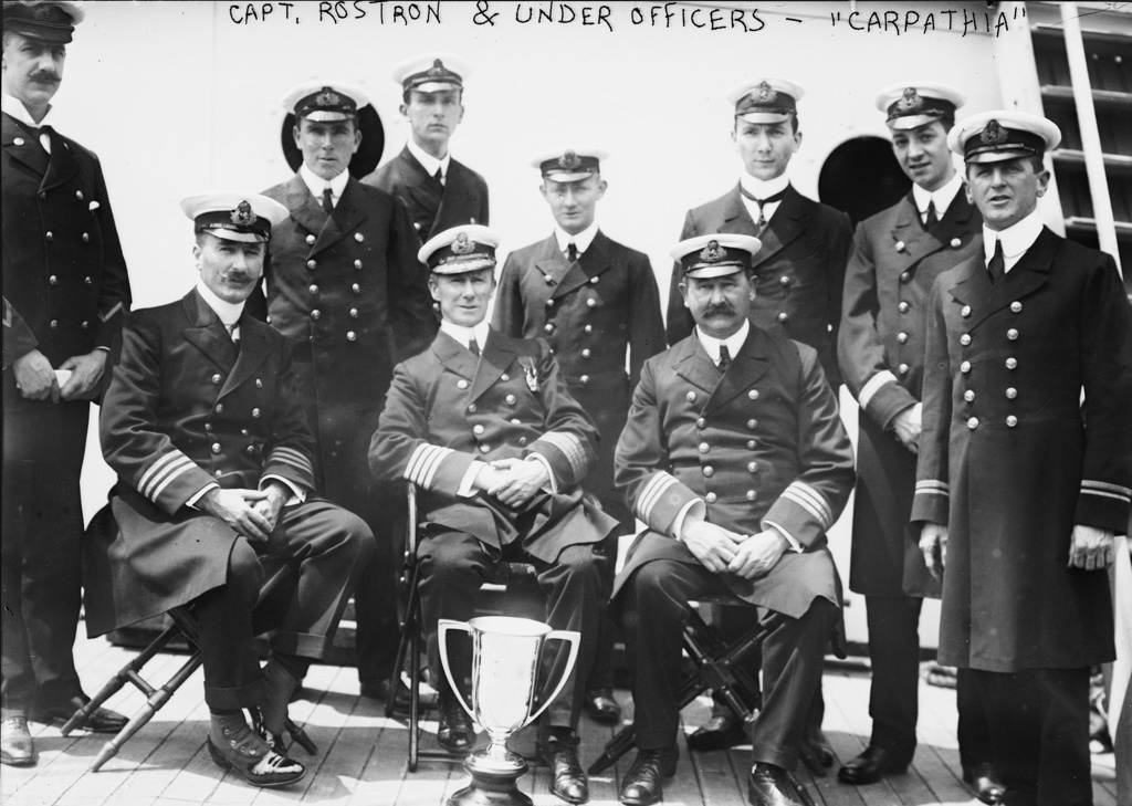 Captain Arthur Rostron and under officers of RMS Carpathia (Cunard), with loving cup presented to him by survivors of wreck of RMS Titanic (White Star Line),  12 April 1912 in recognition of  his heroism in the rescue. Shipwreck Disaster : Stock Photo