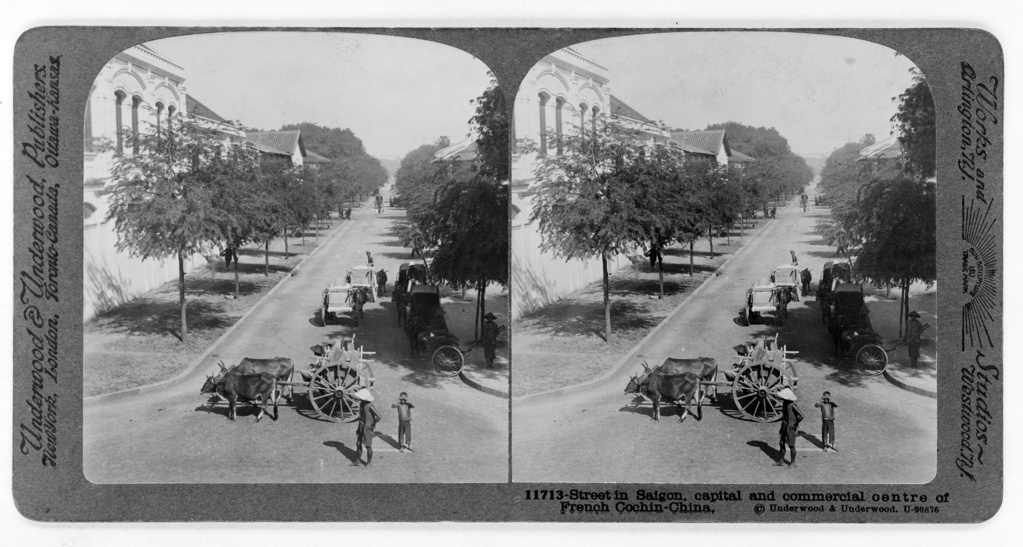 Stock Photo: 1746-3728 Street in Saigon, French Cochin-China, c1915.  Saigon, South Vietnam was the capital and commercial centre of French colonialism in French Indo-China. Pair of stereoscope photographs. Transport Bullock Cart