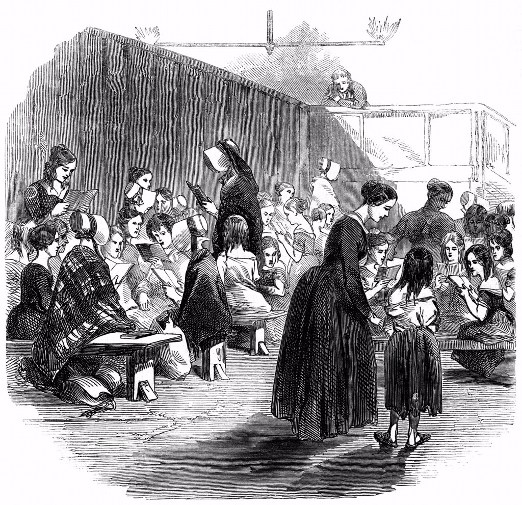 Teaching girls to read in The Ragged School Union (formed 1844) school, Lambeth, London.  From The Illustrated London News 11 April 1868. Wood engraving. : Stock Photo