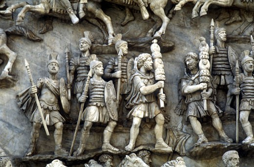Roman soldiers taking part in Decursio - ritual circling of funeral pyre. Detail of relief from the Antonine Column, Rome erected c180-196 by Commodus : Stock Photo