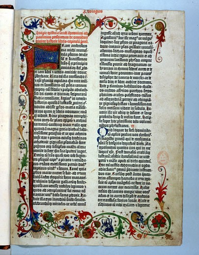 Stock Photo: 1746-975 Page of Bible printed by Gutenberg, 1456. Illuminated border typical of a manuscript.