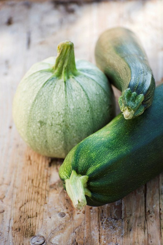 Zucchini and squash on wooden background : Stock Photo
