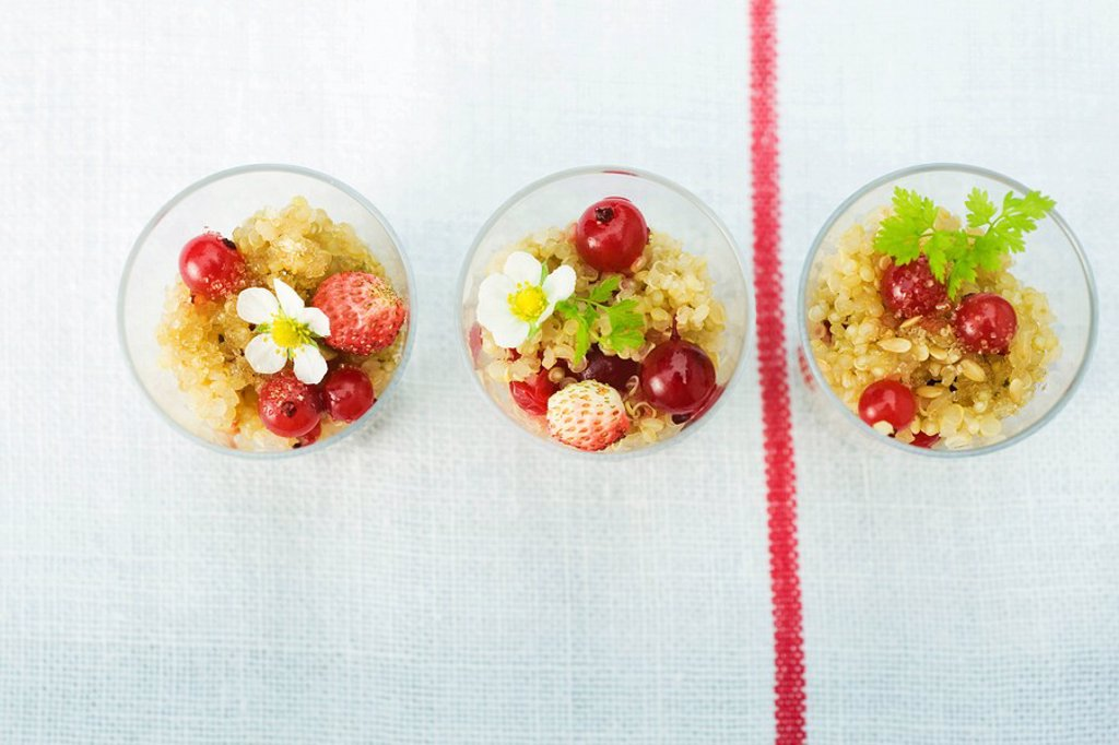 Bowls of quinoa and fruit : Stock Photo