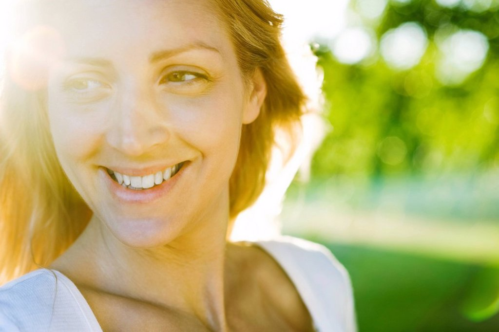 Young woman outdoors on sunny day, portrait : Stock Photo