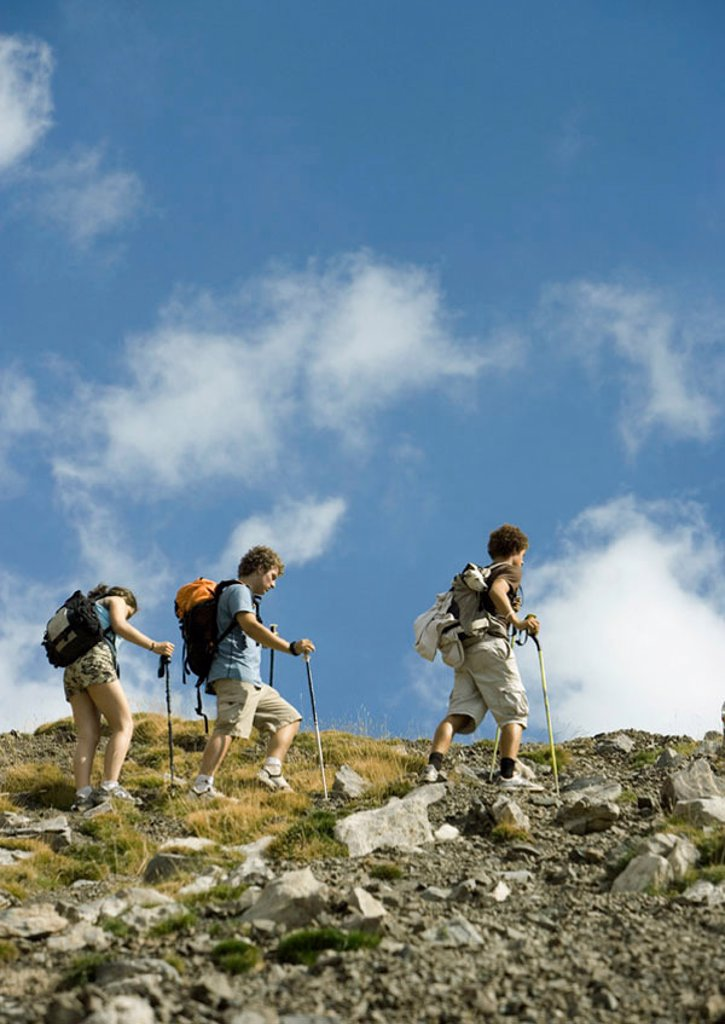 Hikers on mountainous landscape : Stock Photo