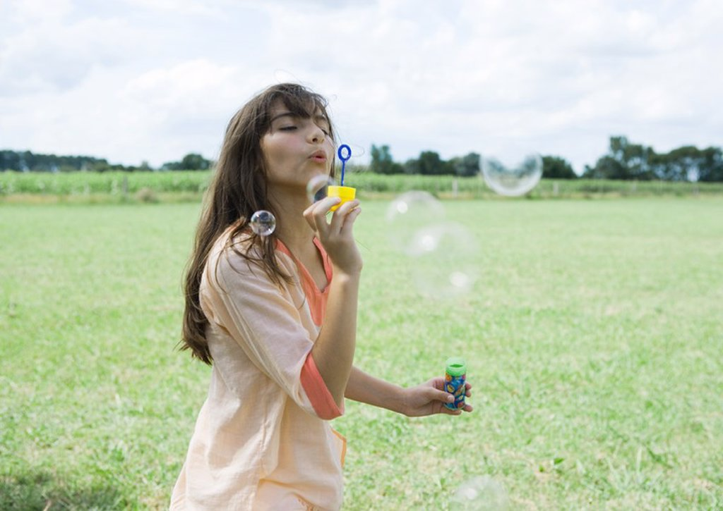 Stock Photo: 1747R-13625 Girl blowing bubbles