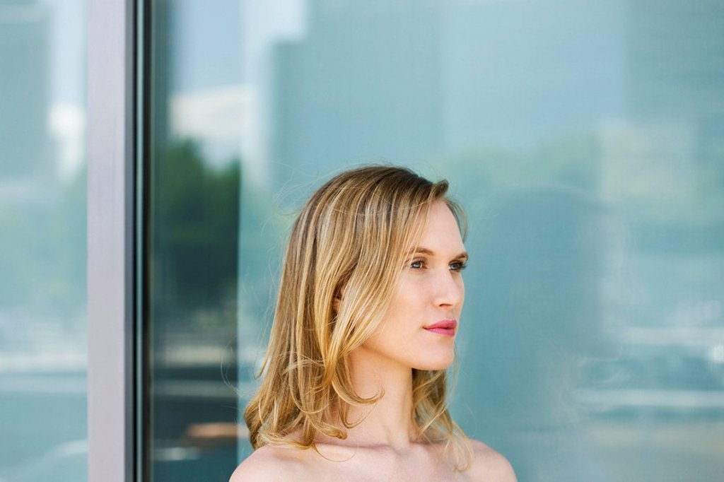 Woman looking away in thought, portrait : Stock Photo