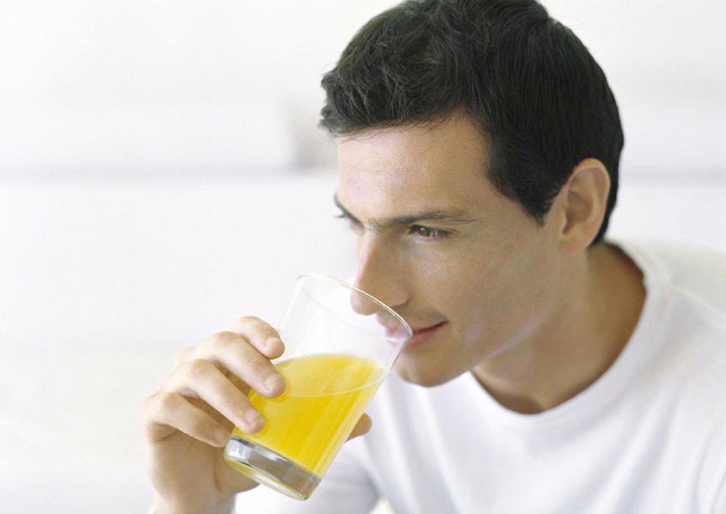 Stock Photo: 1747R-14544 Man drinking juice