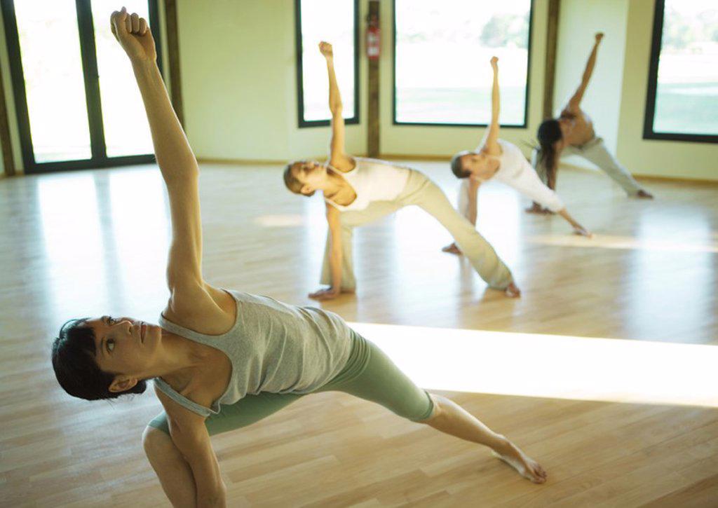 Stock Photo: 1747R-15549 Yoga class doing triangle pose