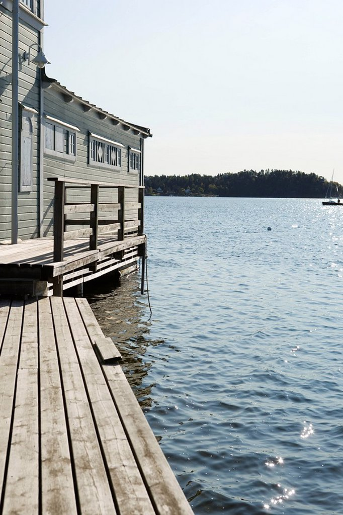 Pier and boathouse on lake : Stock Photo