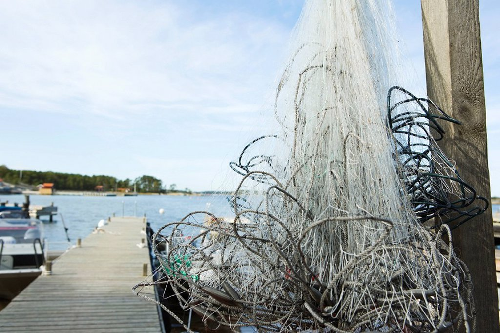 Stock Photo: 1747R-15901 Tangled fishing nets on dock