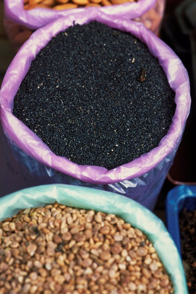Nigella seeds and lentils in buckets, high angle view : Stock Photo