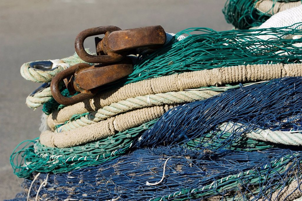 Fishing nets and ropes in a heap, extreme close-up : Stock Photo