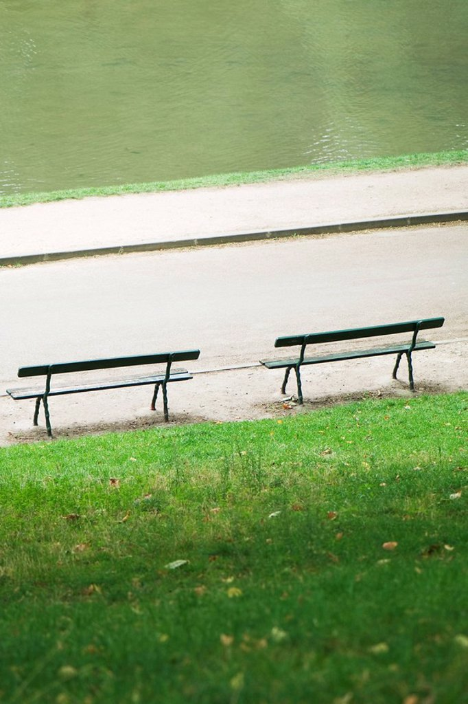 France, Paris, benches facing water in park : Stock Photo