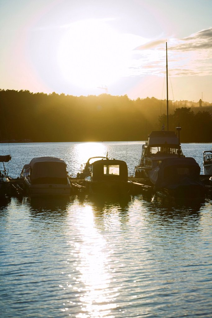 Sweden, Stockholm, Lake Malaren, sun setting over marina : Stock Photo