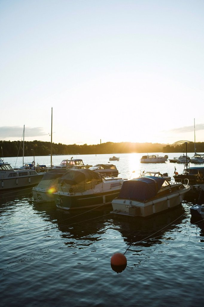 Sweden, Stockholm, Lake Malaren, marina at sunset : Stock Photo