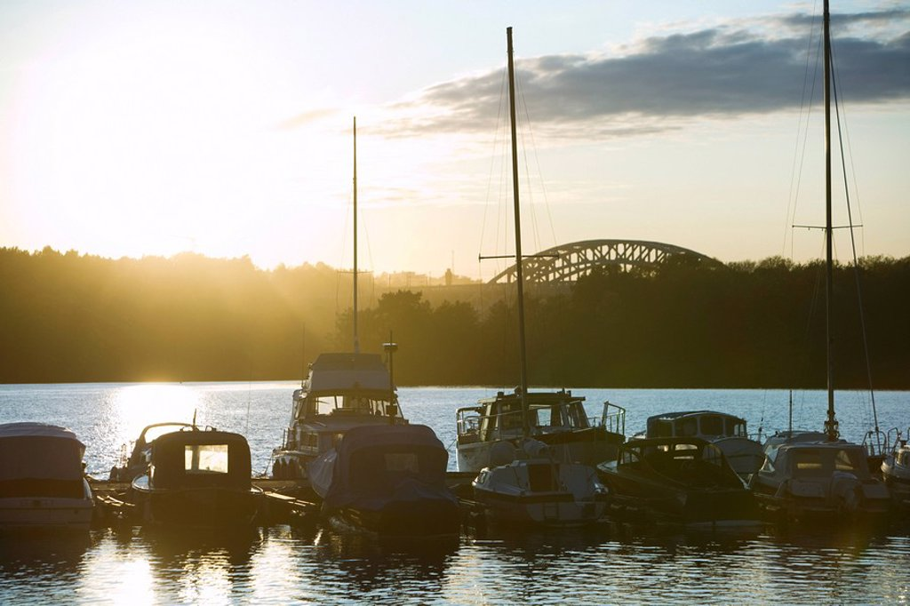 Stock Photo: 1747R-16148 Sweden, Stockholm, Lake Malaren, marina at sunset