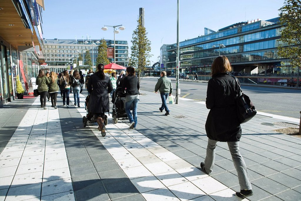 Sweden, Stockholm, pedestrians walking on wide sidewalk : Stock Photo