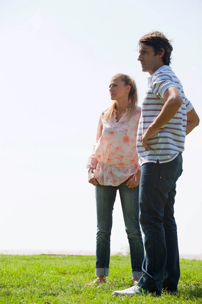 Mature couple standing on meadow : Stock Photo