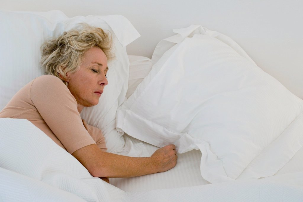 Stock Photo: 1747R-17720 Mature woman sleeping in bed