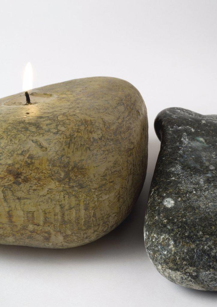 Stone-shaped candle : Stock Photo