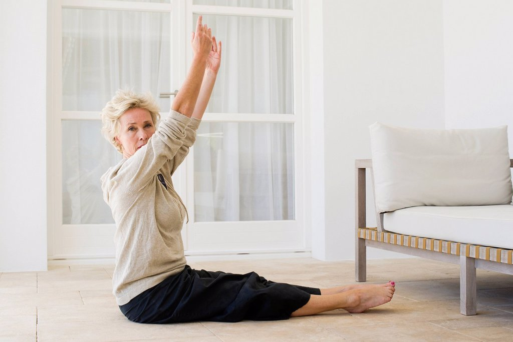 Stock Photo: 1747R-17842 Mature woman practicing yoga on floor