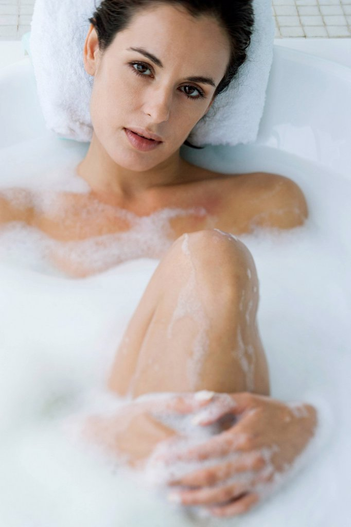 Woman relaxing in bubble bath : Stock Photo