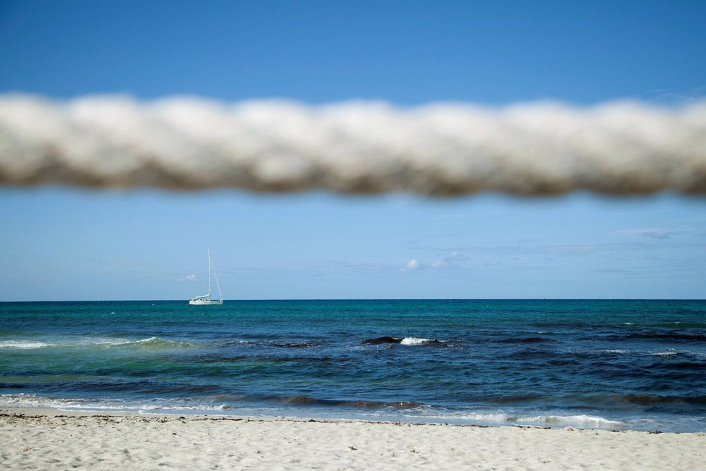 Stock Photo: 1747R-18345 Beach scene, rope in foreground
