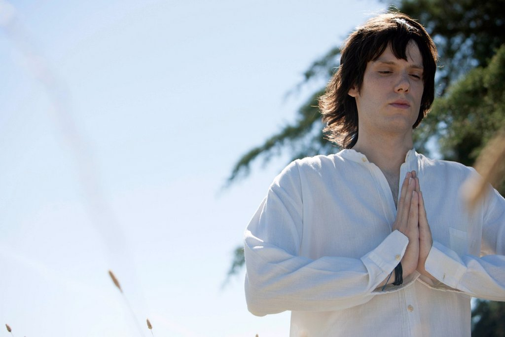 Stock Photo: 1747R-18368 Young man meditating outdoors