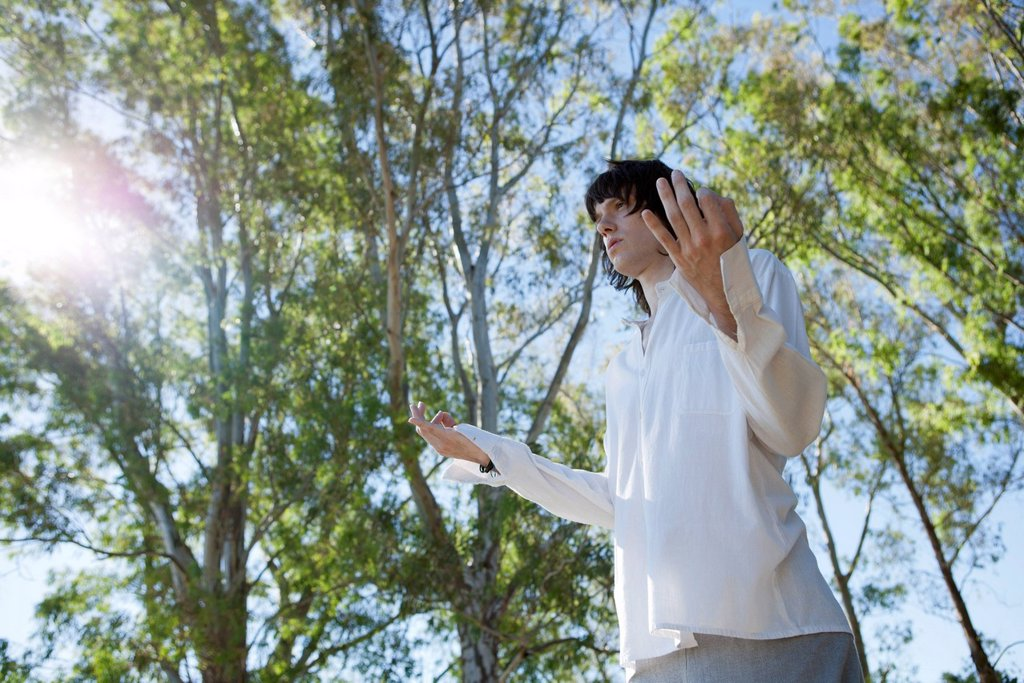 Stock Photo: 1747R-18400 Young man meditating outdoors