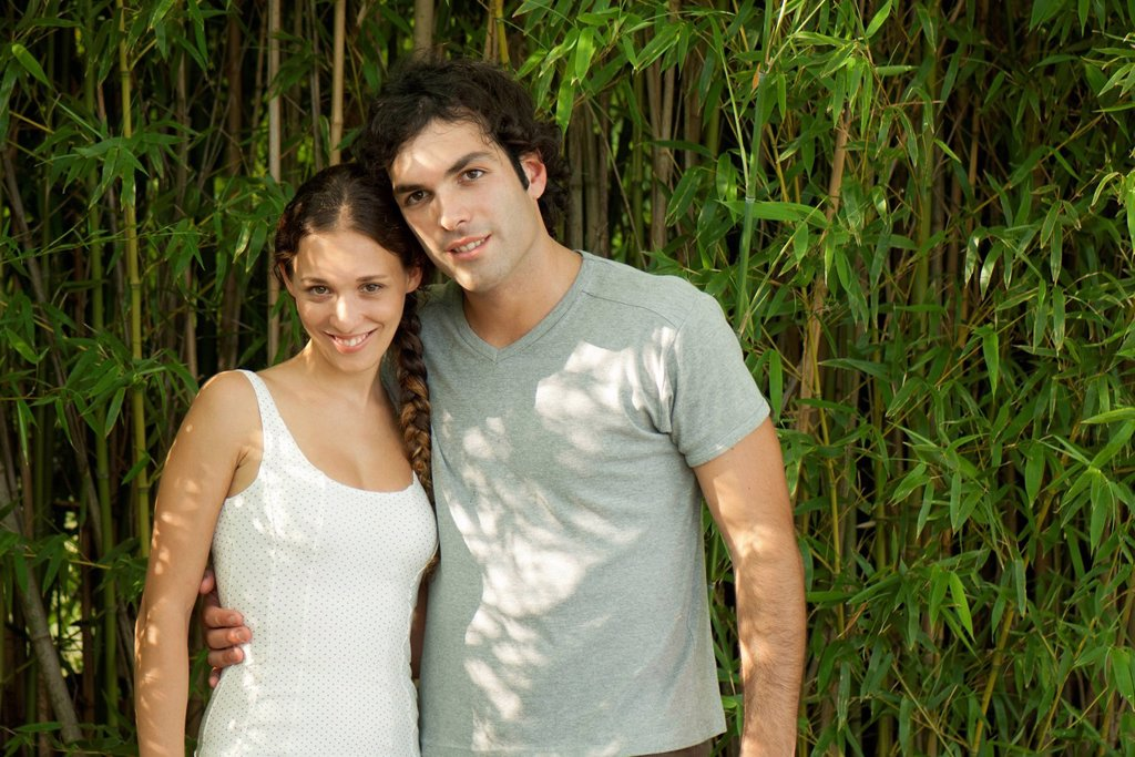 Young couple together outdoors, portrait : Stock Photo