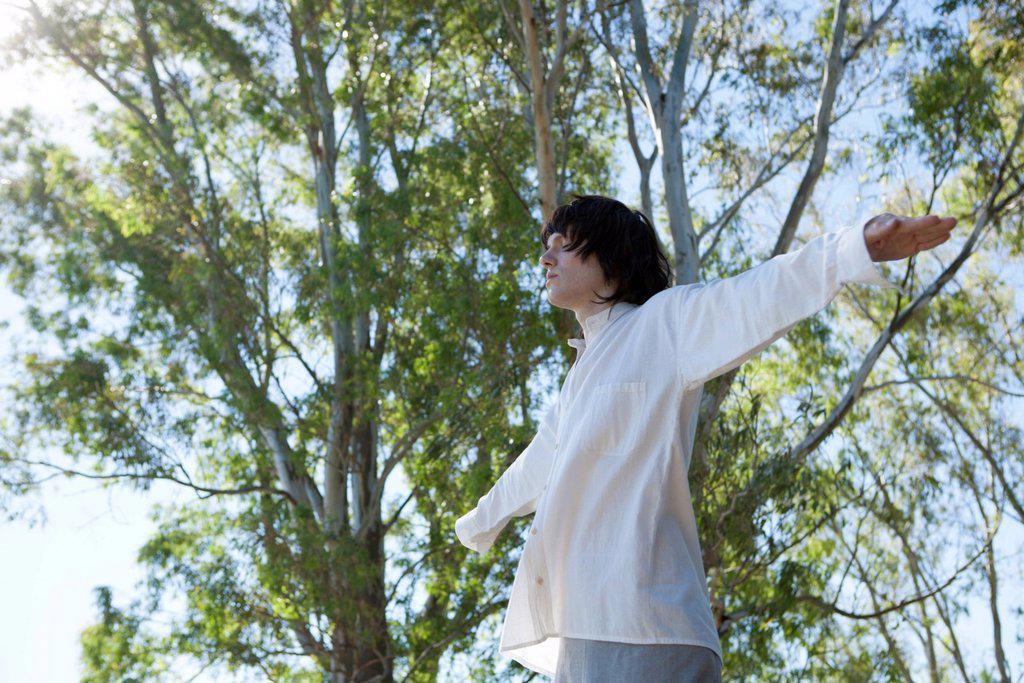 Young man meditating outdoors : Stock Photo