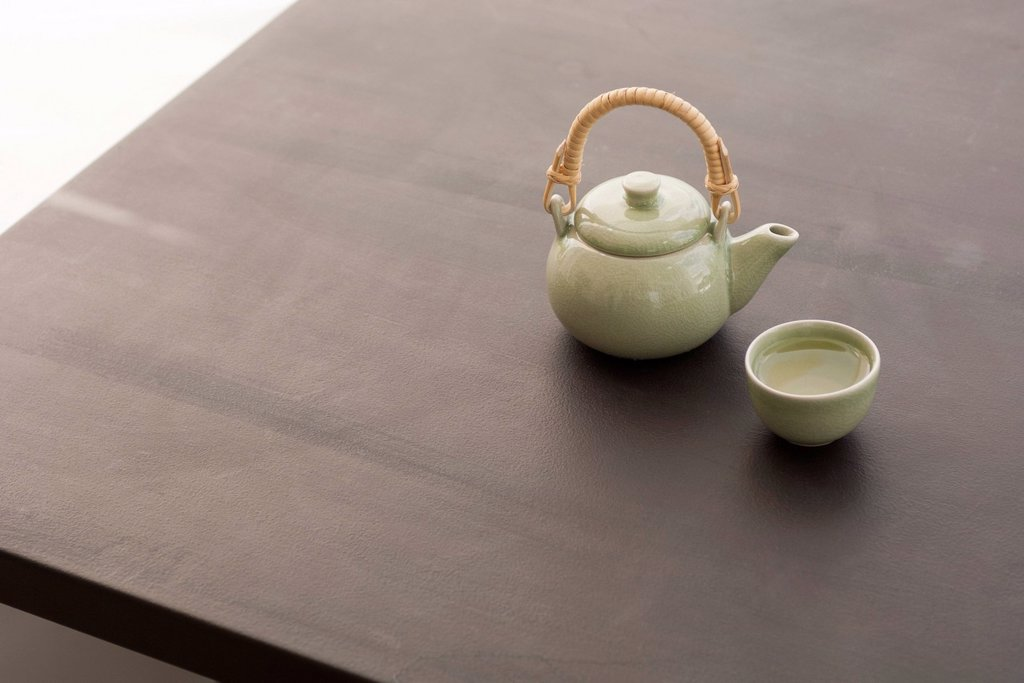 Teapot and cup of tea : Stock Photo
