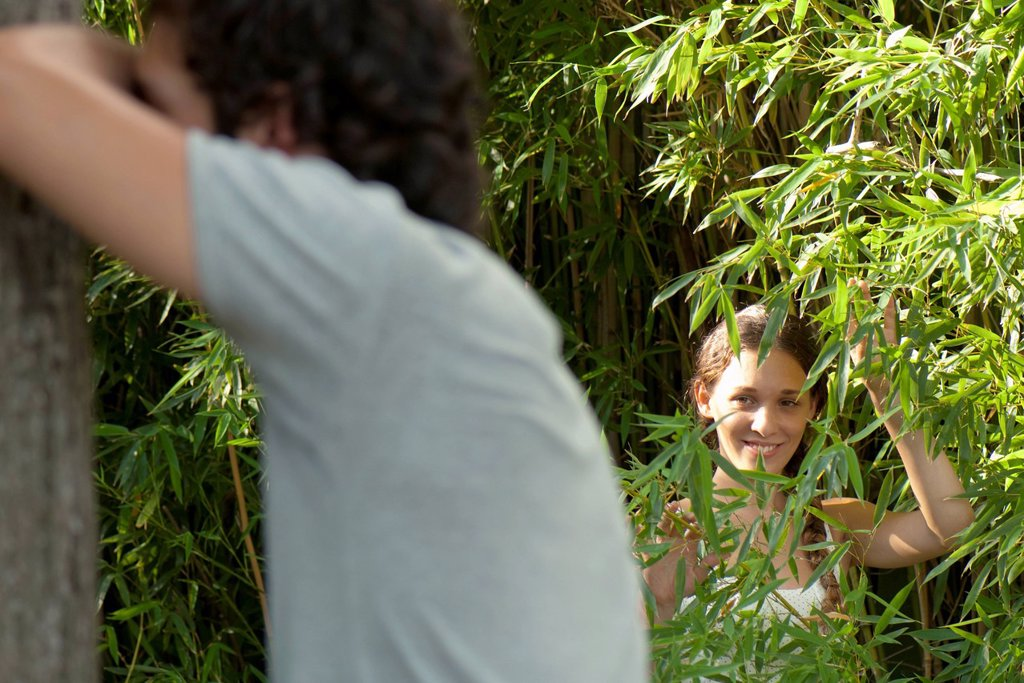Young woman playing hide_and_seek : Stock Photo