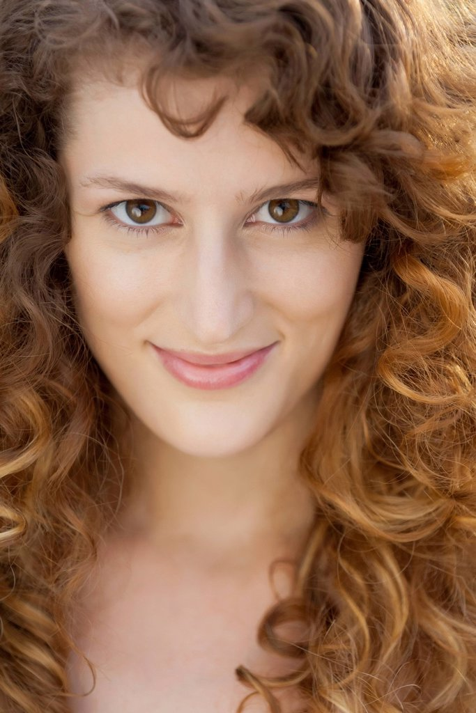 Stock Photo: 1747R-18708 Young woman with curly hair, portrait