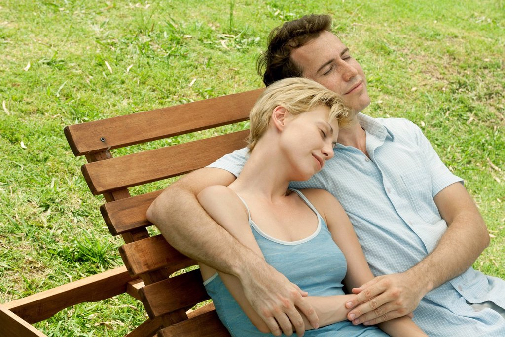 Stock Photo: 1747R-18720 Couple relaxing together on lounge chair