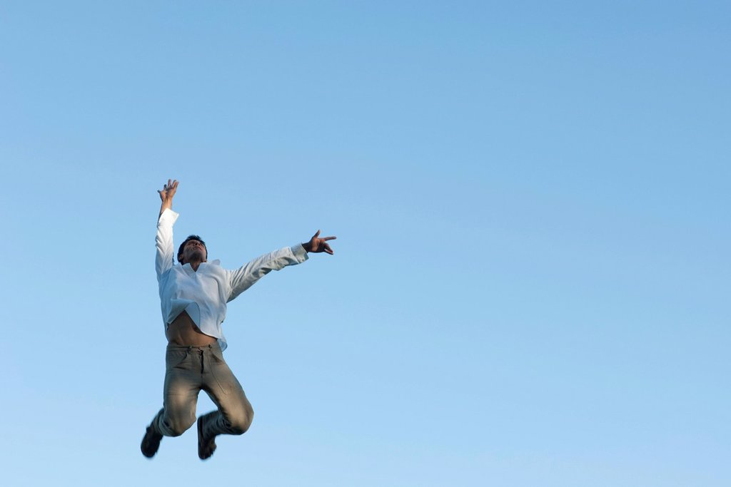 Stock Photo: 1747R-18766 Man jumping in air