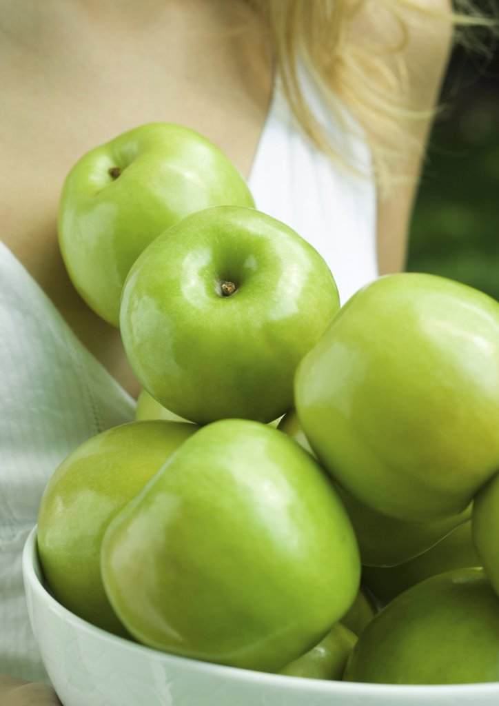 Woman holding bowl of apples, close-up of apples : Stock Photo