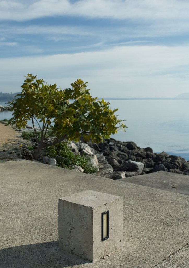 Stock Photo: 1747R-4791 Cement block near edge of lake