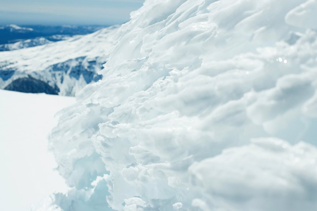 Stock Photo: 1747R-5348 Ice formation, mountain range in background