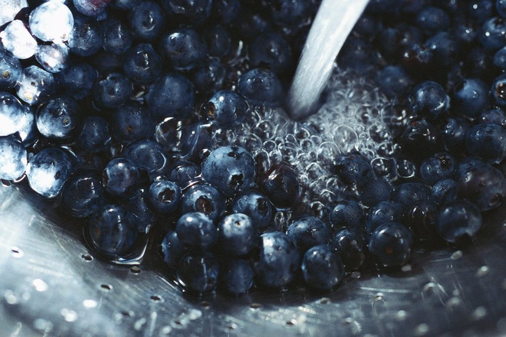 Stock Photo: 1747R-5980 Blueberries in colander being rinsed