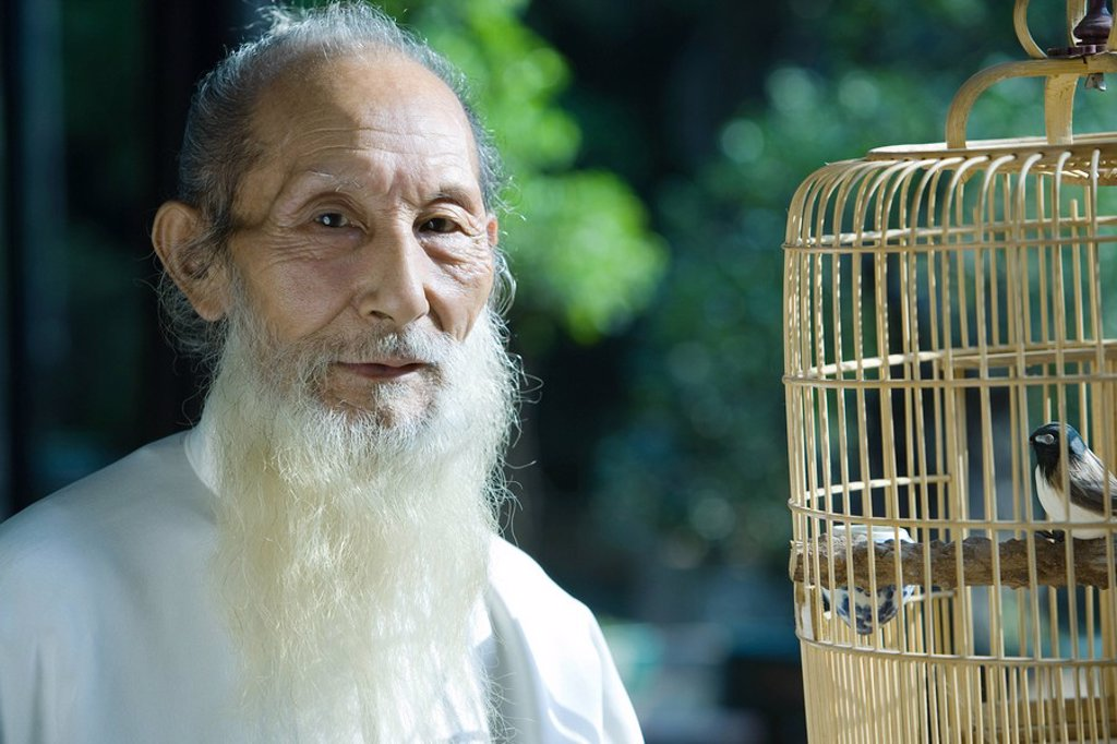 Stock Photo: 1747R-7323 Elderly man wearing traditional Chinese clothing, with bird cage, portrait