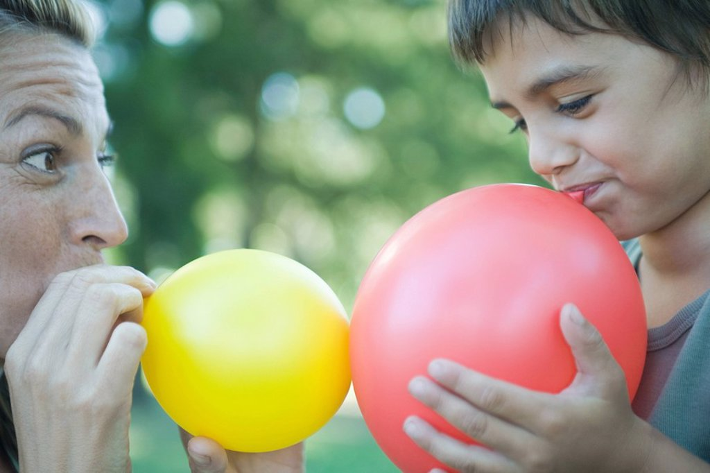 Stock Photo: 1747R-7426 Boy and mother blowing up balloons