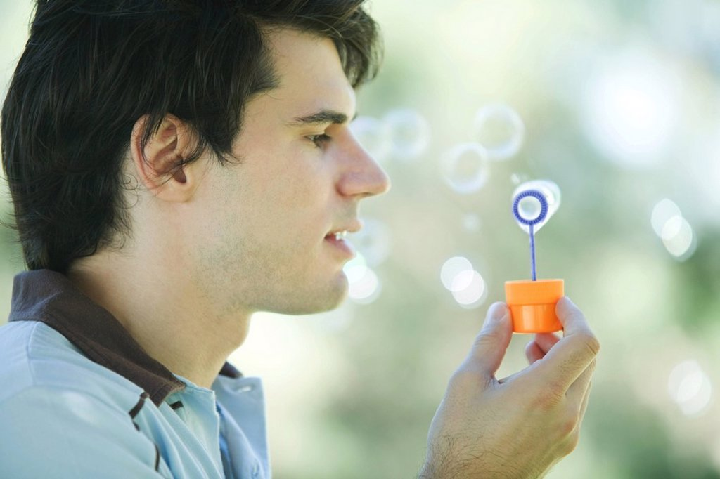 Man blowing bubbles : Stock Photo