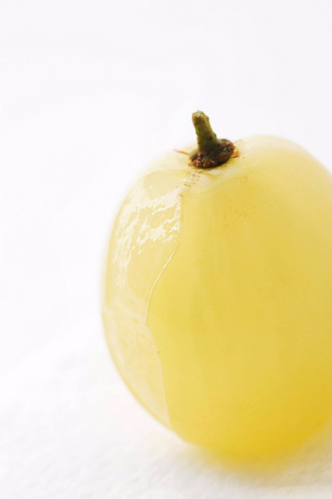 Stock Photo: 1747R-9355 White grape, partially peeled, close-up
