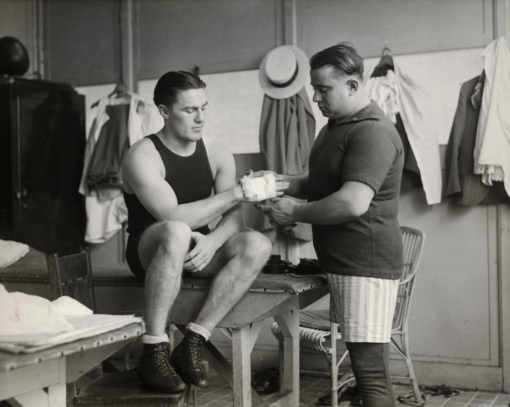 Stock Photo: 1749-129 Light Heavyweight Boxing Champion Tommy Loughran with trainer Brady, Philadelphia Arena