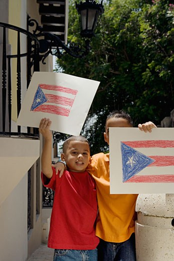 Stock Photo: 1757R-1216 Boys holding drawing of the Puerto Rican flag.