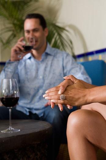 Close-up of woman's hands at social gathering. : Stock Photo